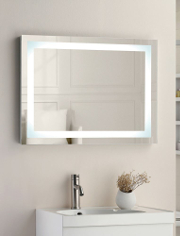 A rectangular mirror with LED light built into it over a vanity