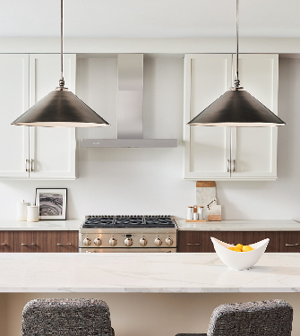 Two Coolie Shade Pendants Designed by Thomas O'Brien hangning over a kitchen island